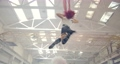 Sporty woman with red hair is doing aerial gymnastics in a factory building, 4k 68557187