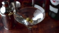bartender serving martini in glass at bar 68713303