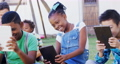Kids using digital tablet in the backyard of house 4k 68876216