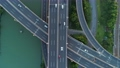 Aerial drone view of highway multi-level junction road with moving car at sunset. Active movement of transport cars vehicles in different directions. China. Top down view, camera moves down. 68962417