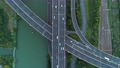 Aerial drone view of highway multi-level junction road with moving car at sunset. Active movement of transport cars vehicles in different directions. China. Top down view, camera moves down. 68962418