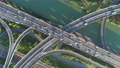 Aerial drone view of highway multi-level junction road with moving car at sunset. Active movement of transport cars vehicles in different directions. China. Top down view, rotation shot. 68962419