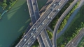 Aerial drone view of highway multi-level junction road with moving car at sunset. Active movement of transport cars vehicles in different directions. China. Top down view, rotation shot. 68962420