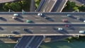 Aerial drone view of highway multi-level junction road with moving car at sunset. Active movement of transport cars vehicles in different directions. China. Top down view. Camera moves up. 68962421