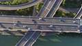 Aerial drone view of highway multi-level junction road with moving car at sunset. Active movement of transport cars vehicles in different directions.The concept of the urban. China. Top down view. 68962425