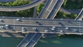 Aerial drone view of highway multi-level junction road with moving car at sunset. Active movement of transport cars vehicles in different directions.The concept of the urban. China. Top down view. 68962429