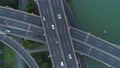 Aerial drone view of highway multi-level junction road with moving car at sunset. Active movement of transport cars vehicles in different directions. China. Top down view, rotation shot. 68962430