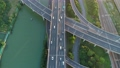 Aerial drone view of highway multi-level junction road with moving car at sunset. Active movement of transport cars vehicles in different directions. China. Camera moves forward. 68962449