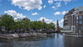 Time lapse of Amsterdam cityscape with view of canal in Netherlands. 68993542