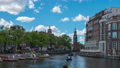 Amsterdam cityscape with view of canal and church time lapse. 68993543