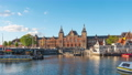 Amsterdam city skyline with Centraal Station in Amsterdam, Netherlands. 68993548