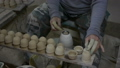 hands working clay on potter's wheel, Lampang in Thailand 69001830