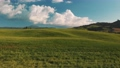 Beautiful and miraculous colors of green spring panorama landscape of Tuscany, Italy. Sunny morning near Pienza. Aerial view  69103103