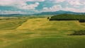 Beautiful and miraculous colors of green spring panorama landscape of Tuscany, Italy. Sunny morning near Pienza. Aerial view  69103106