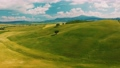 Beautiful and miraculous colors of green spring panorama landscape of Tuscany, Italy. Sunny morning near Pienza. Aerial view  69103108