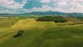 Beautiful and miraculous colors of green spring panorama landscape of Tuscany, Italy. Sunny morning near Pienza. Aerial view  69103109
