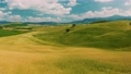 Beautiful and miraculous colors of green spring panorama landscape of Tuscany, Italy. Sunny morning near Pienza. Aerial view  69103114