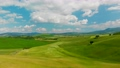 Beautiful and miraculous colors of green spring panorama landscape of Tuscany, Italy. Sunny morning near Pienza. Aerial view  69103118