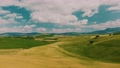 Beautiful and miraculous colors of green spring panorama landscape of Tuscany, Italy. Sunny morning near Pienza. Aerial view  69103119