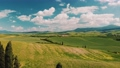Beautiful and miraculous colors of green spring panorama landscape of Tuscany, Italy. Sunny morning near Pienza. Aerial view  69103120