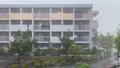 夏のゲリラ豪雨の中の市営住宅の風景 69255783