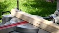 Slow motion. Sawing a wooden panel with a miter saw 69298227