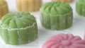 Making colorful snow skin moon cake, molding a shape recipe of sweet snowy mooncake, traditional savory dessert for Mid-Autumn Festival, close up, lifestyle, panning 69382772