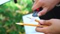Woman painter artist sharpening pencils using sharp knife, hands closeup. 69776584