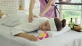 Young beautiful woman doing traditional massage in spa beauty salon 70049533