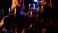Friends clink champagne in club 70145467