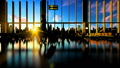 Young woman silhouette with suitcase walking in airport against beautiful sunset 70200354