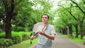 Senior man walking with a tennis racket 70204164