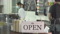 reopen the coffee shop after the quarantine.  young man who owner a retail restaurant is preparing cafe. Barista and the waitress manage sales at counter. 70309009
