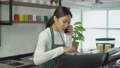 Young woman cafe owner talking on phone Take customer order in coffee shop 70309011