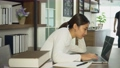Attractive young Asian woman working on laptop in coffee shop. 70309013