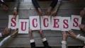 Business people put SUCCESS letters 70356559