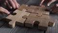 Business people and wooden puzzle 70356561