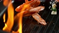 Super slowmotion footage of throwing fresh prawns and seasoning on ignited pan, 1000fps 4k 70564629