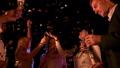 Happy people dance in confetti 70592350
