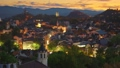 Evening view of Plovdiv old town, Bulgaria. Old illuminated houses and sunset sky. Zoom out shot. View from Nebet Tepe hill Plovdiv city canter. 4K 70816340