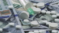 Medicines and syringe on the US dollars 70850834