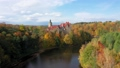 Aerial view of Czocha Castle surrounded by autumn forest and Lesnianskie Lake 70884850
