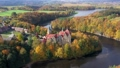 Aerial view of Czocha Castle surrounded by autumn forest and Lesnianskie Lake 70895779