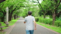 Back view of a senior man walking in the park 70954317