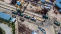 [Time-lapse] [Construction site] Trucks and excavators at the construction site 70977713