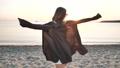 Happy beautiful girl walks, enjoys sea beach, carefree fun summer relax outdoors 70993740