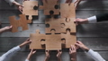 Business people team assembling puzzle 71048682