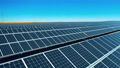 Drone shot of solar panel rows at a solar power facility 71386435