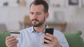 Man Reacting to Online Shopping Problem on Smartphone 71469667