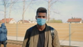 Portrait of young african man in medical mask looking to the camera 71659252